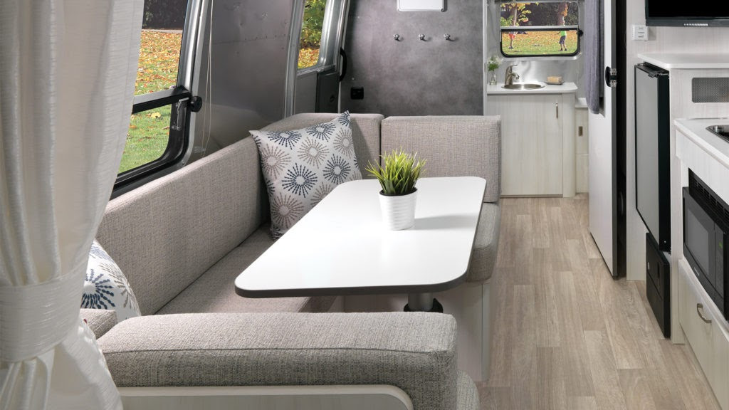 Airstream-Bambi-22FB-Dune-Interior-Dinette-and-Conversion-Bed-Featured-Hotspot-1024x576